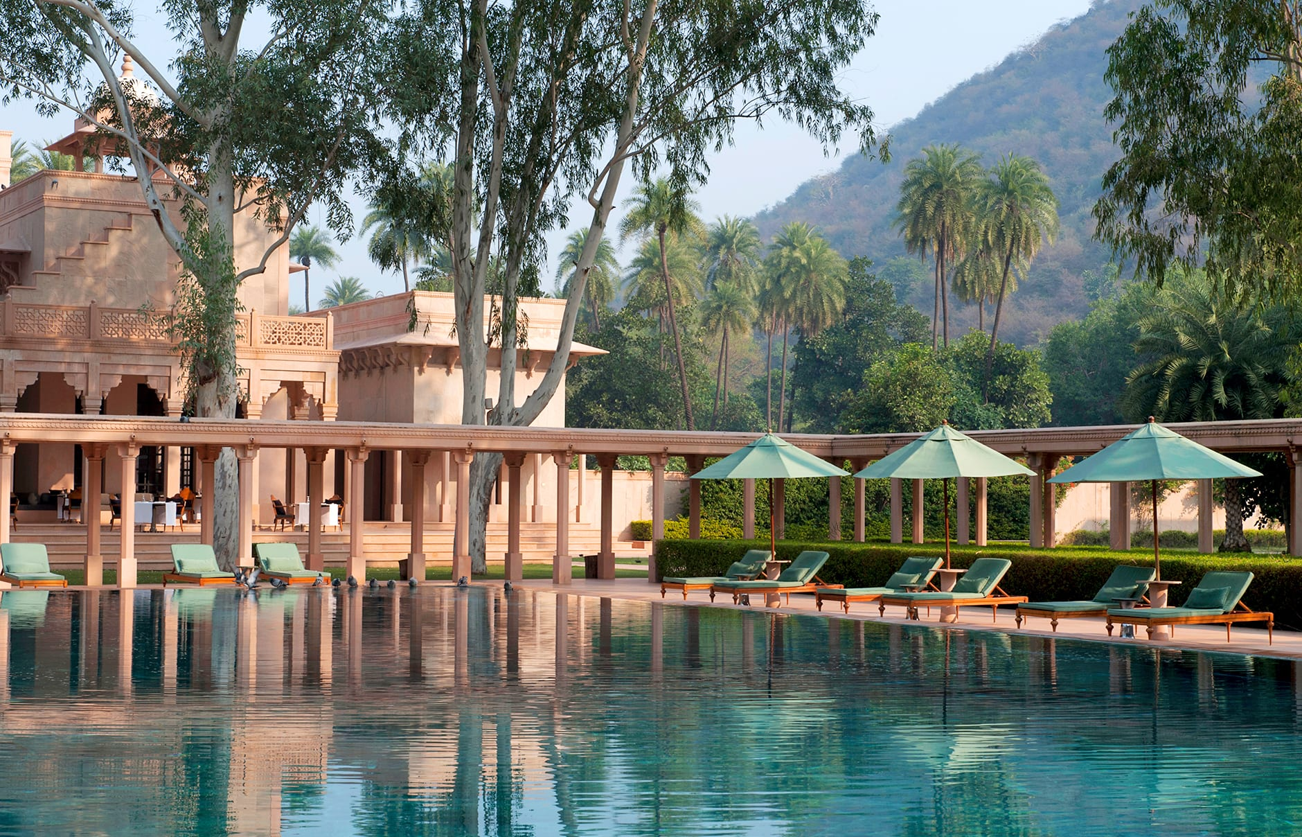 Poolside Loungers. Amanbagh, Alwar, Rajasthan, India. Luxury Hotel Review by TravelPlusStyle. Photo © Aman Resorts