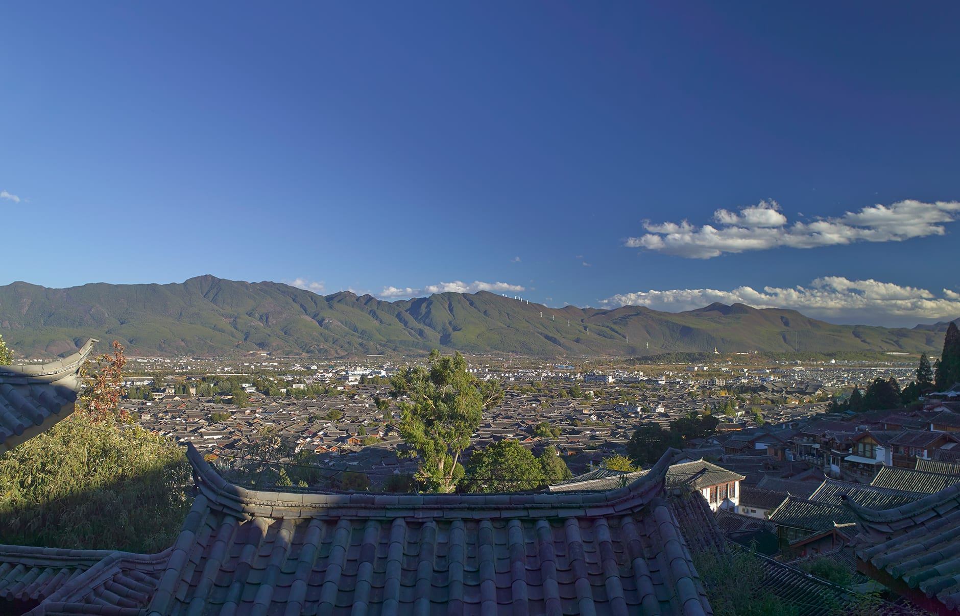 Lijiang Old Town (View from AmanDayan). Amandayan, Lijiang, China. Luxury Hotel Review by TravelPlusStyle. Photo © Aman Resorts