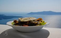 Greek salad in Santorini, Greece. © Travel+Style