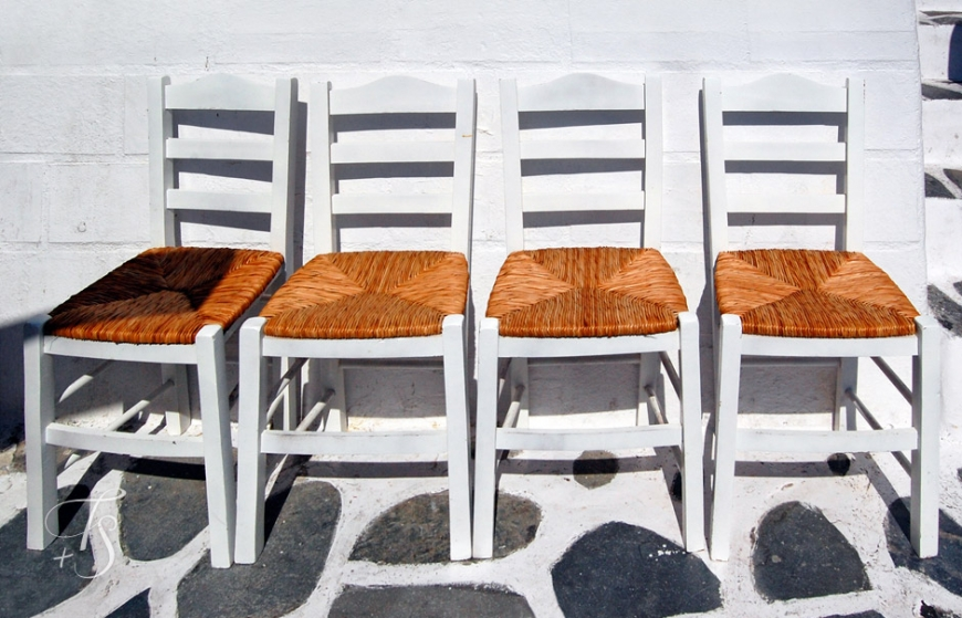 Chairs in Mykonos, Greece. © Travel+Style