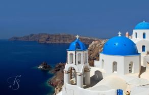 Blue domes in Oia, on the island of Santorini, Greece. © Travel+Style