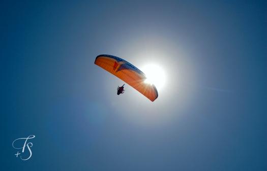 Paragliding above Zighy Bay, Oman. © Travel+Style