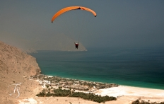 Paragliding above Zighy Bay, Oman. © Travel+Style