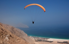 Paragliding into the Six Senses Zighy Bay, Oman. ©Travel+Style