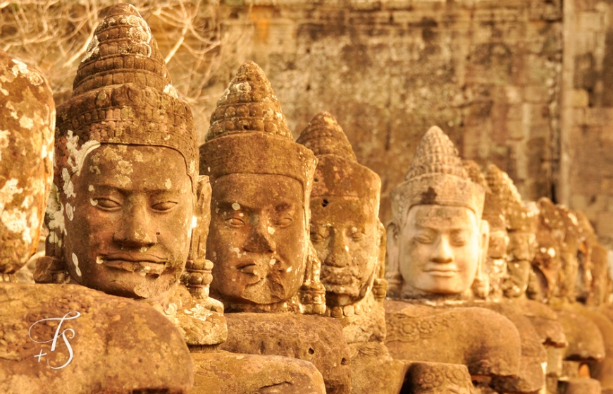 Statues at the South gate of Angkor Thom. ©Travel+Style