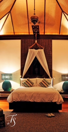 Villa bedroom. Four Seasons Resort Koh Samui. © Travel+Style