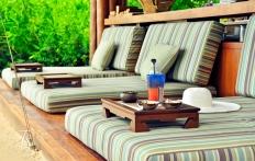 Beach Bar, Four Seasons Resort Koh Samui. © Travel+Style