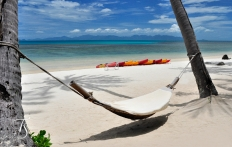 Hammock On The Beach, Four Seasons Resort Koh Samui. © Travel+Style