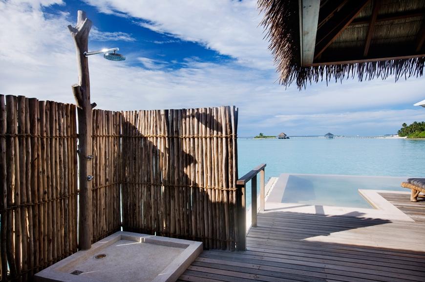 Water Villa outdoor shower. TravelPlusStyle.com