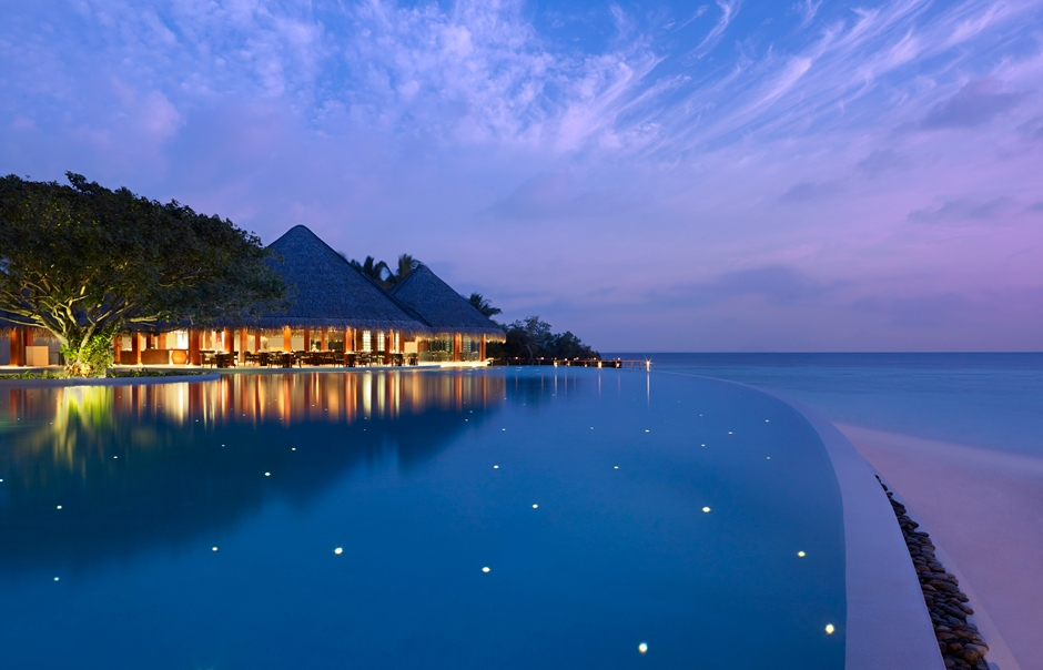 Swimming Pool at twillight. Dusit Thani Maldives. © 2010 Dusit International