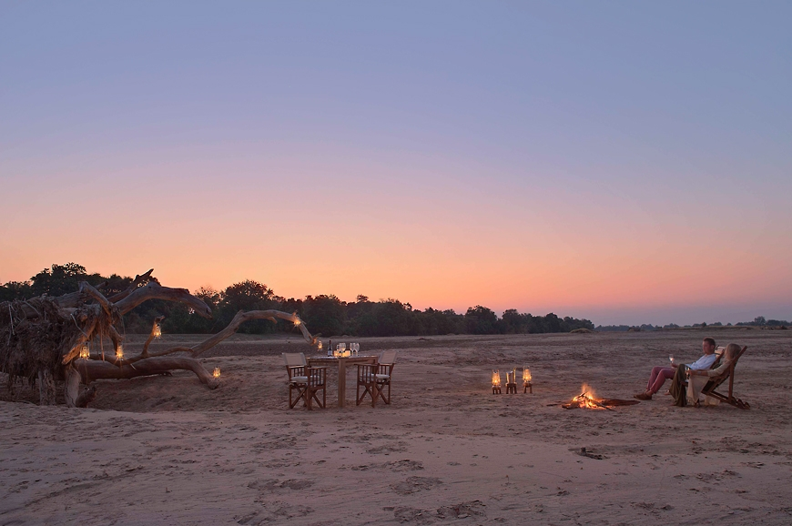 Sundowners in the riverbed. Chinzombo Camp, Zambia. travelplusstyle.com