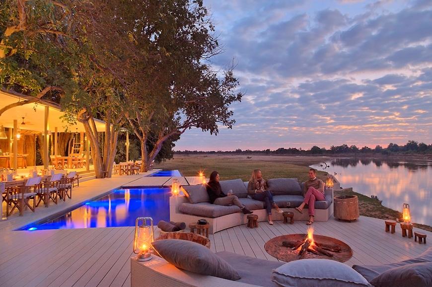 the fire pit. Chinzombo Camp, Zambia. travelplusstyle.com