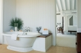 Master bathroom. Parrot Cay by COMO, Turks & Caicos. © COMO Hotels and Resorts