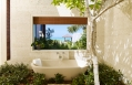 Open air bathtub. Parrot Cay by COMO, Turks & Caicos. © COMO Hotels and Resorts