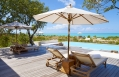 Sun loungers. Parrot Cay by COMO, Turks & Caicos. © COMO Hotels and Resorts