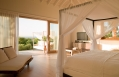 Three Bedroom Villa bedroom. Parrot Cay by COMO, Turks & Caicos. © COMO Hotels and Resorts