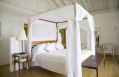 Villa bedroom. Parrot Cay by COMO, Turks & Caicos. © COMO Hotels and Resorts