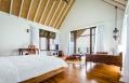 COMO Villa, bedroom. COMO Cocoa Island - Maldives. Hotel Review by TravelPlusStyle. Photo © COMO Hotels and Resorts
