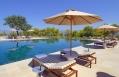 Amanzoe - Swimming Pool Loungers. © Amanresorts