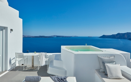 Katikies, Santorini, Greece.  Luxury Hotel Review by TravelPlusStyle. Photo © Katikies