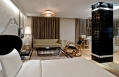 The living room and the bed of a Witt Istanbul Hotel suite. © Witt Istanbul Hotel