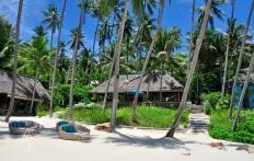On The Beach. Four Seasons Resort Koh Samui. © Travel+Style