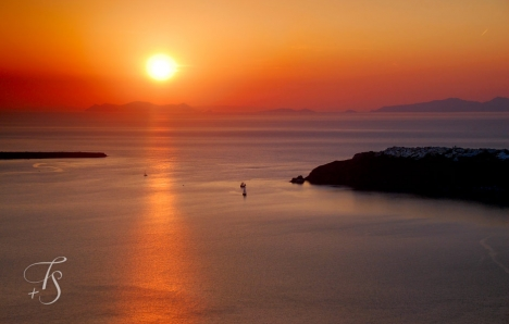 Sunset over the Santorinian caldera, Greece. © Travel+Style