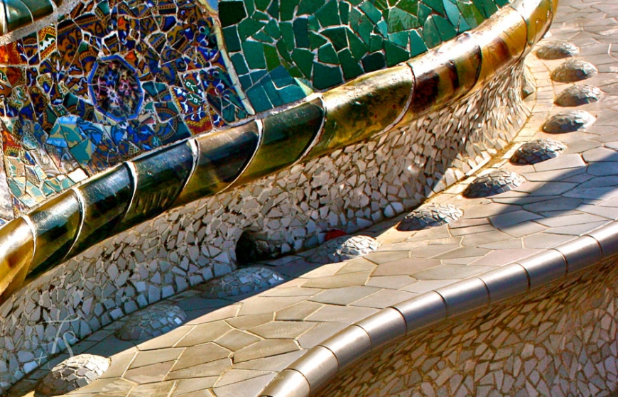 A colourful bench in Parc Guell. © Travel+Style