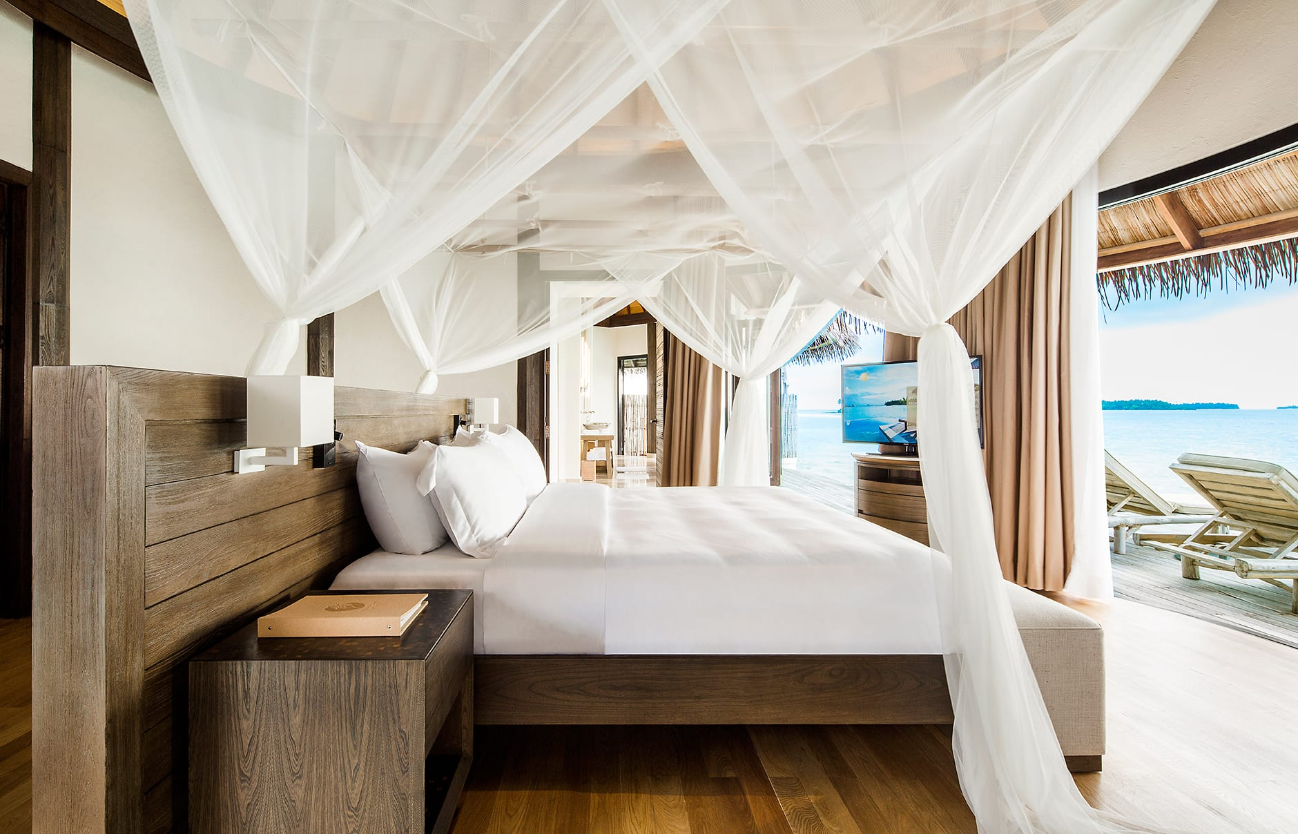 Overwater Villa bedroom. COMO Maalifushi, Maldives. Hotel Review by TravelPlusStyle. Photo © COMO Hotels & Resorts