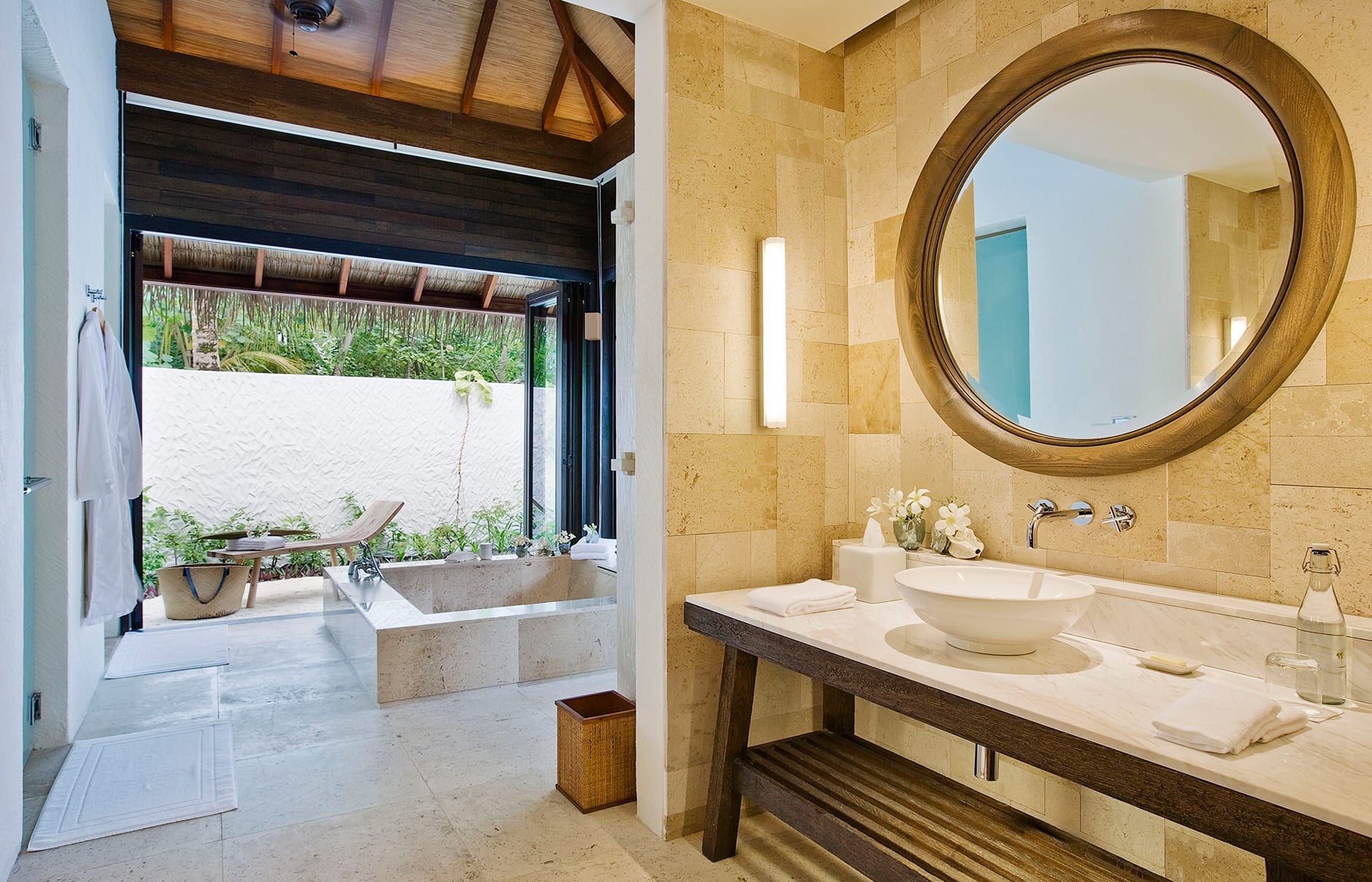 Garden Suite bathroom . COMO Maalifushi, Maldives. Hotel Review by TravelPlusStyle. Photo © COMO Hotels & Resorts