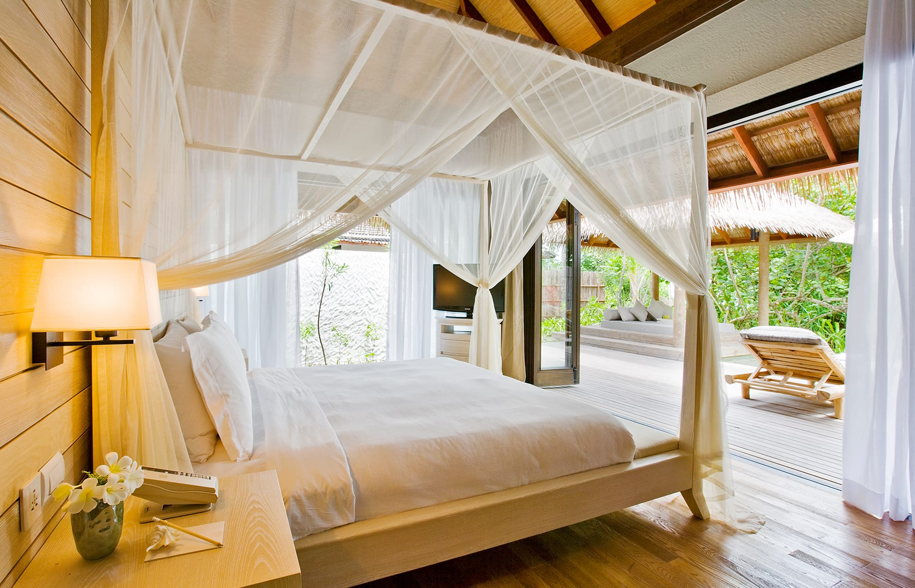 Garden Suite bedroom. COMO Maalifushi, Maldives. Hotel Review by TravelPlusStyle. Photo © COMO Hotels & Resorts