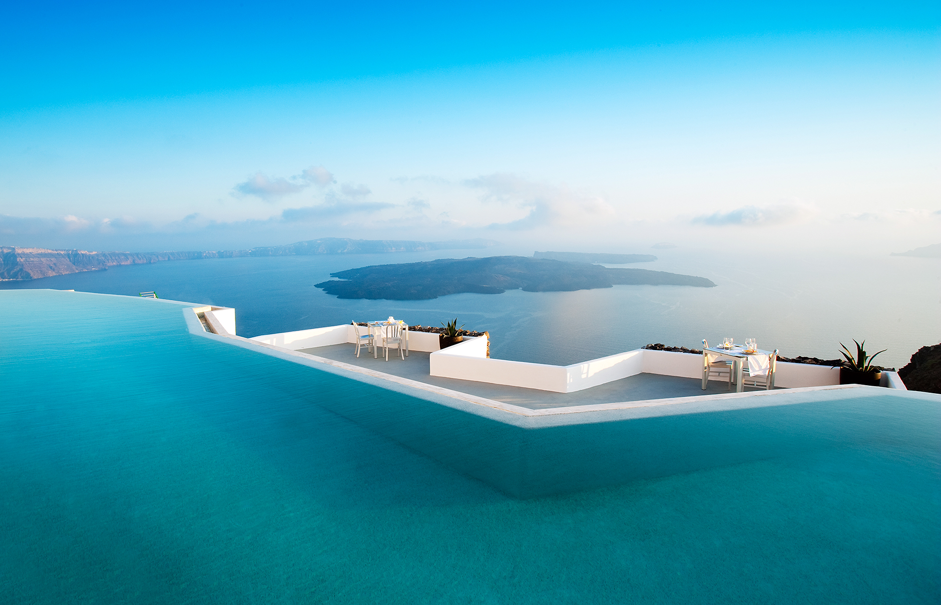 Top 5 luxury boutique hotels of the world - Top 10 Cliff Edge Santorini Hotels Design Buffs Will Love
